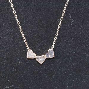 NWOT Rose Gold triple hearts necklace